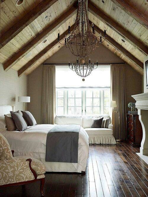 Love this #rustic attic bedroom with a dramatic a-frame ceiling .
