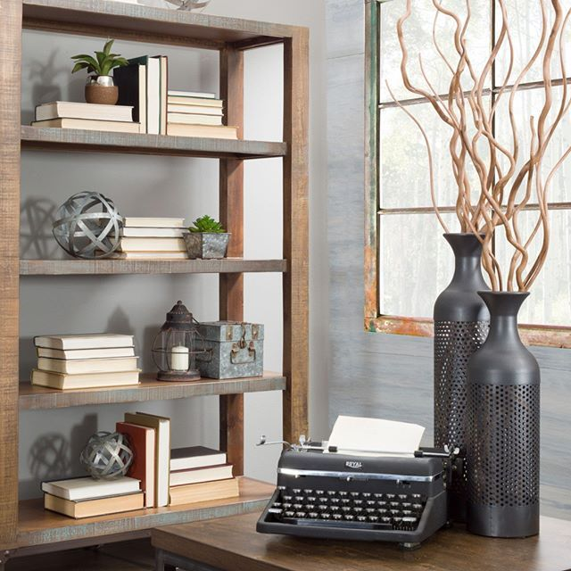 Add in different types of wood and metal accessories to your space .