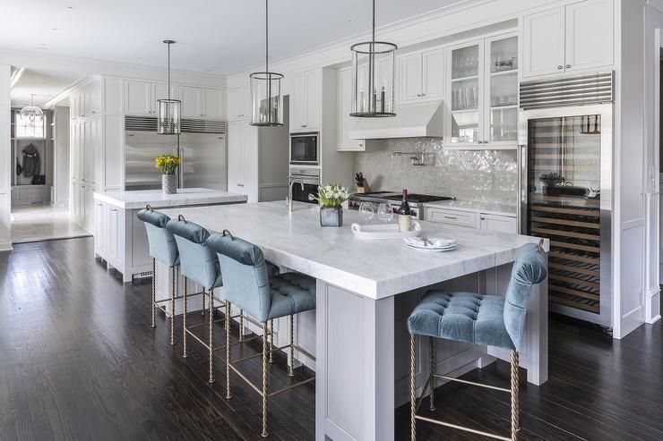 Gray Kitchen Island with Blue Velvet Tufted Counter Stools .
