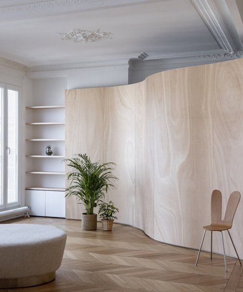 toledano + architects adds curved wooden 'ribbon' to haussmanian .