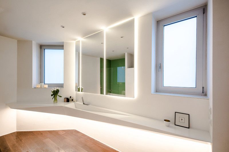 This angular bathroom was inspired by the shape of ice .