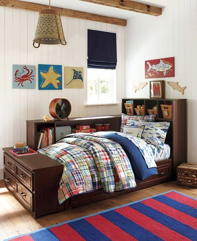 Love the quilted plaid bedding in this boys bedroom photo from .