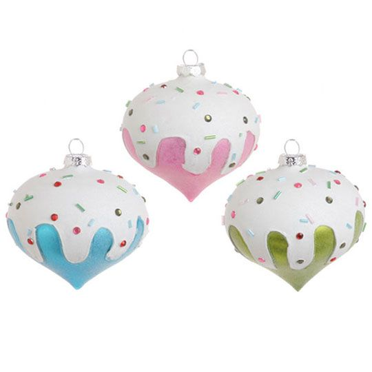 Candy Colored Kismet Ornaments with white frosting and sprinkles .