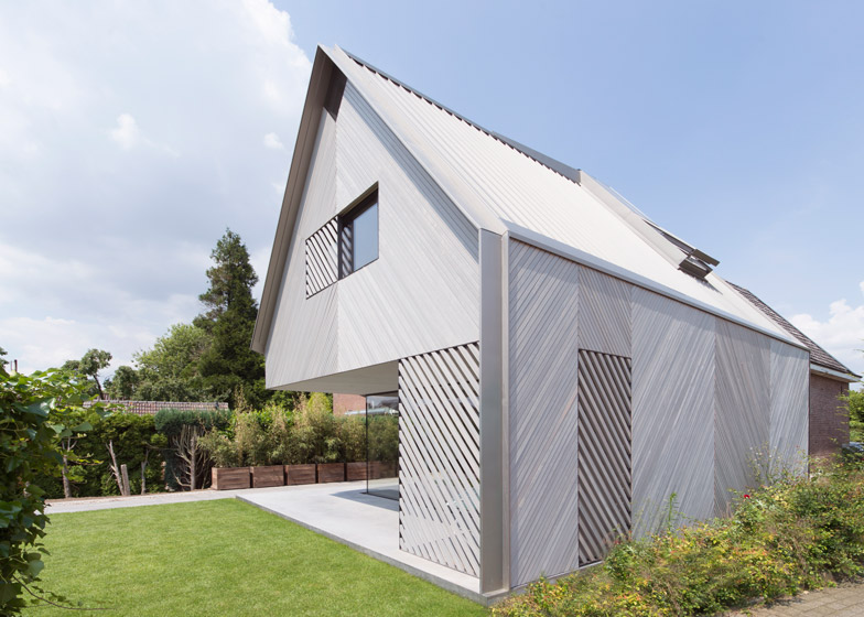 House W extension by Studio Prototype contrasts cedar with brickwo