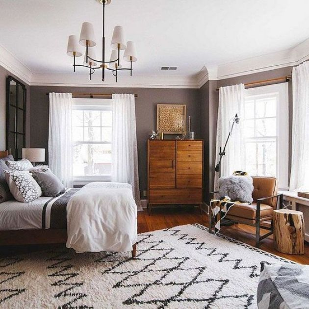 Chic Mid-Century Modern Bedroom With A Rich-Stained Wooden Dresser .