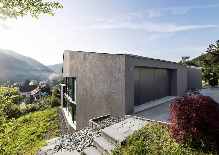 Single family house built on a steep slope that leads to the .