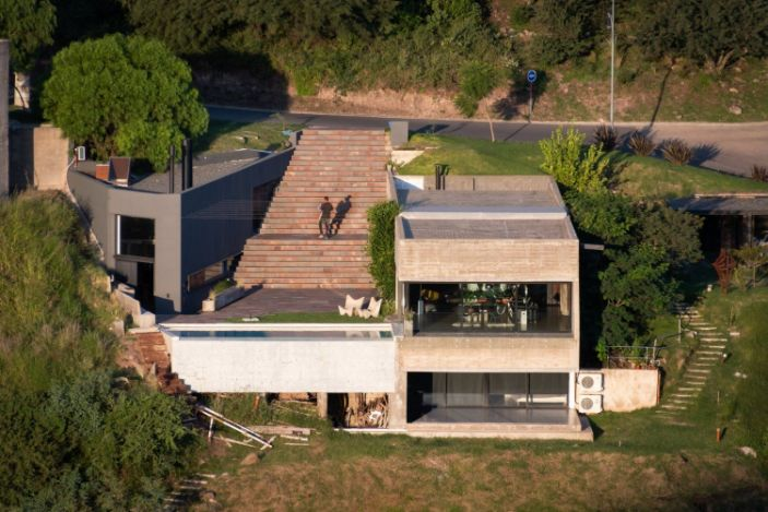 Concrete Home in Argentina Gently Steps Down Onto the Hillsi