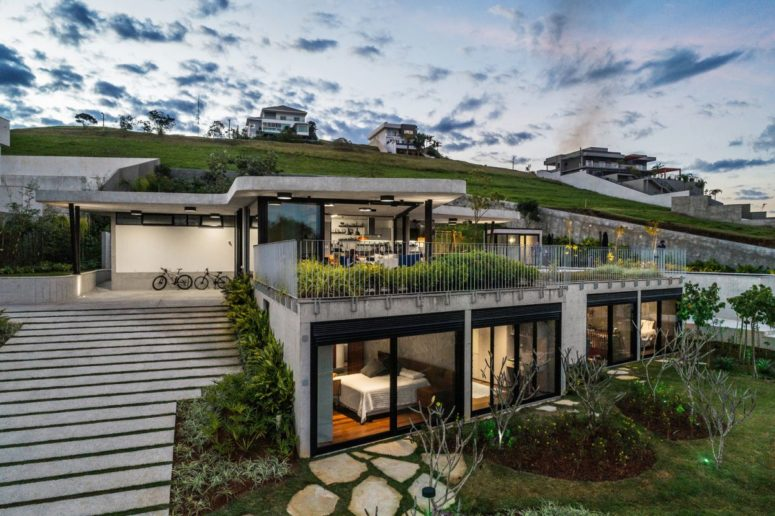 Contemporary Concrete House On A Steep Slope - DigsDi