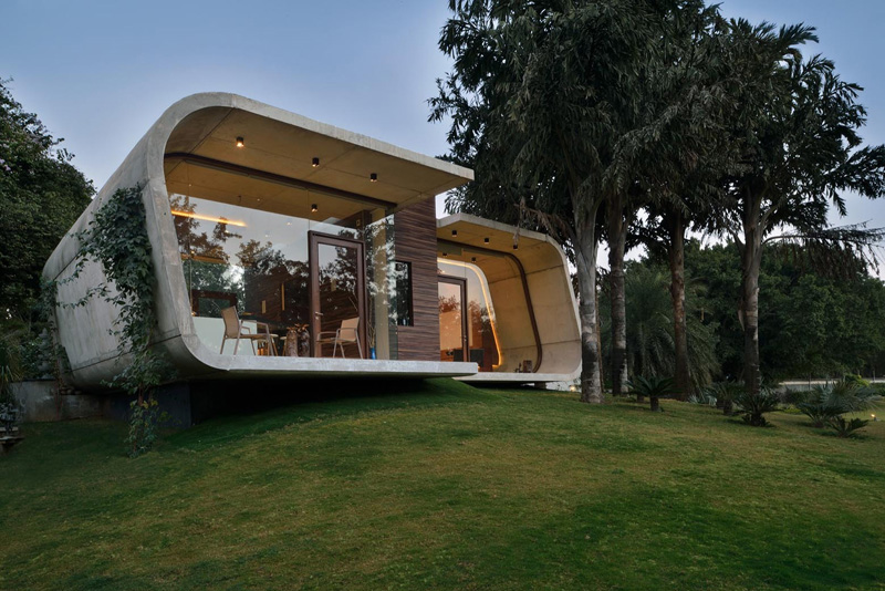 A Curved Concrete Contemporary Pool House in India   Home Design Lov