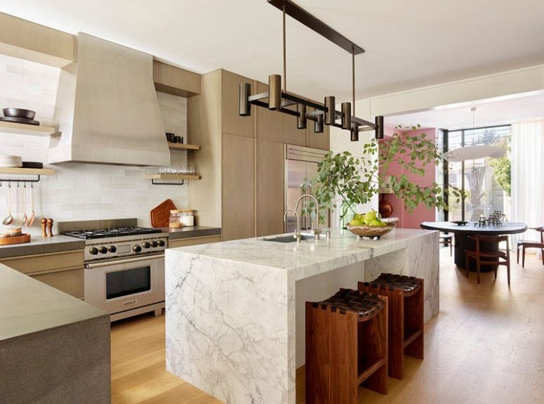 Contemporary House With Whimsy Touches | Marble kitchen island .
