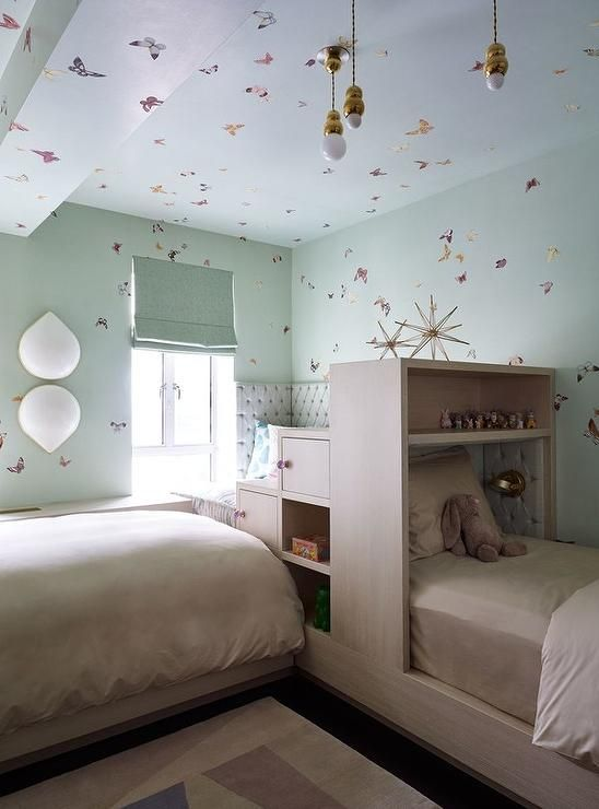 Contemporary girls' bedroom boasts walls clad in whimsical .
