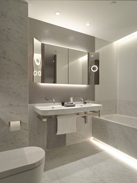 Cool White LED Strip Lights look fantastic in this modern bathroom .