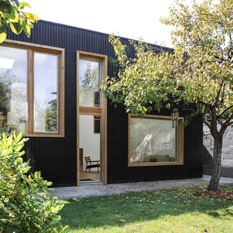 Nantes house extension features blackened wood facad