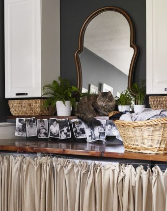 Cleverly disguise functional areas with neutral curtains and fun .