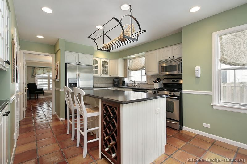 A lovely kitchen with traditional white cabinets, a terracotta .