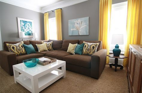 brown, gray, teal and yellow living room with sectional sofa and .