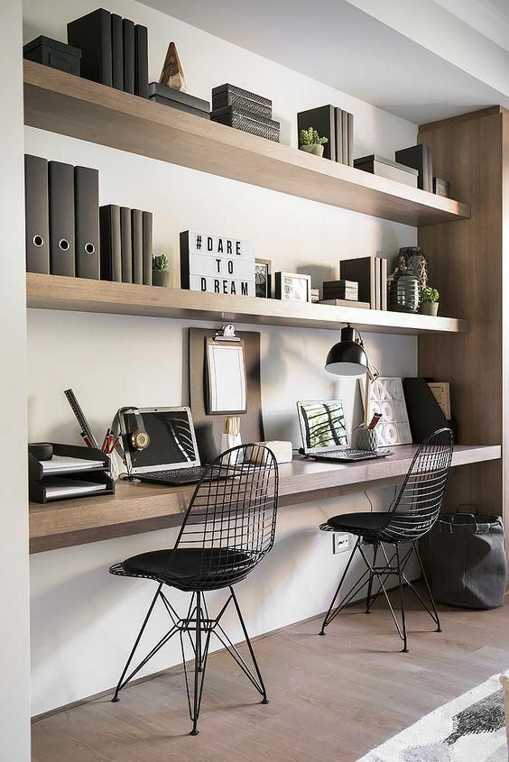 floating shelves in a niche and a floating desk top with the same .