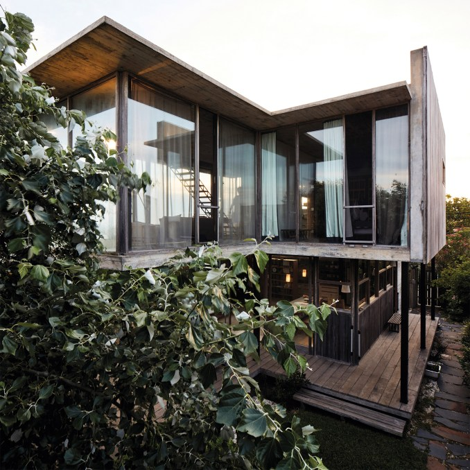 Alejandro Sticotti's holiday home in Uruguay teams weathered wood .