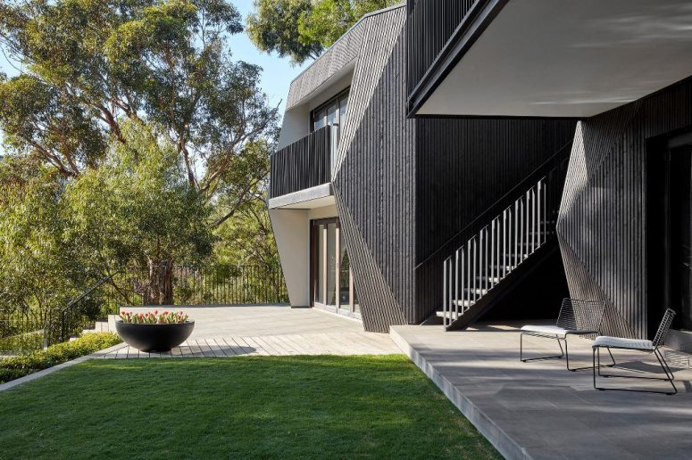 Contemporary River House Clad With Black Cypress - DigsDi