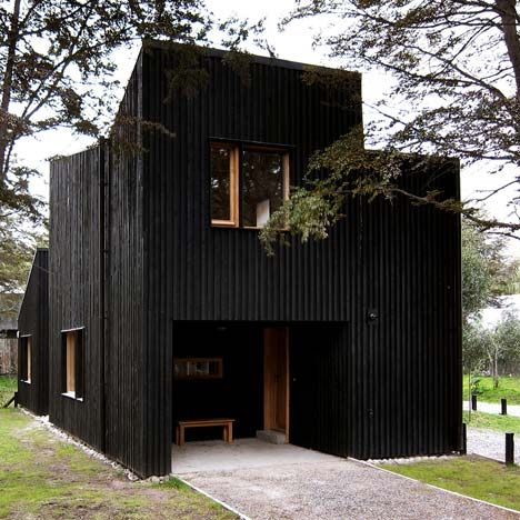 Architects Estudio BaBO clad these three wooden houses in .