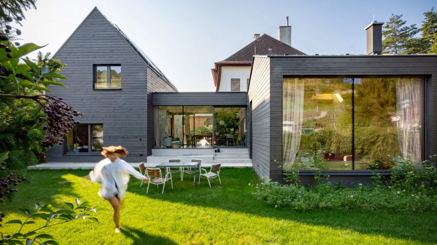 Smartvoll builds gabled timber-clad extension around old cottage .