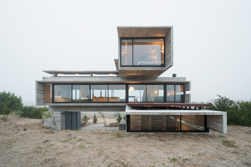 Architect Luciano Kruk designs a house made of three stacked forms .