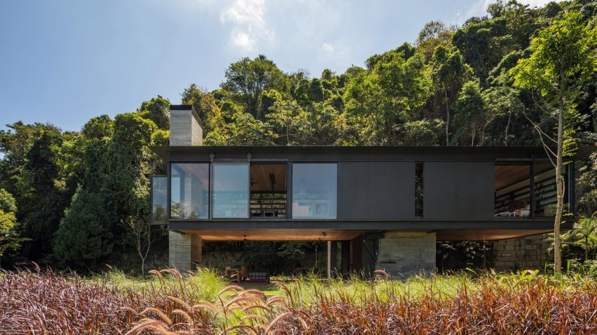 Olson Kundig Rio House is elevated on concrete columns in rainfore