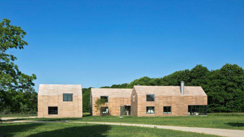 Wood clads gabled volumes of Grove House by Roger Ferris + Partne