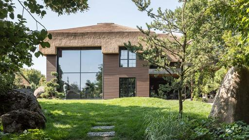 A Thatched Roof House That Blends Ukrainian and Japanese .