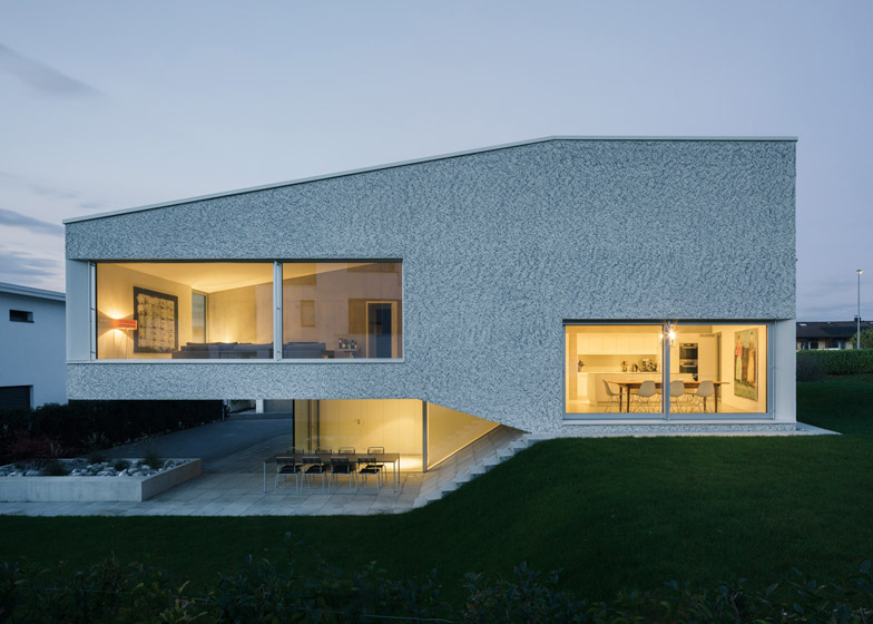 Split-level house by Kit works with the slope of the gard