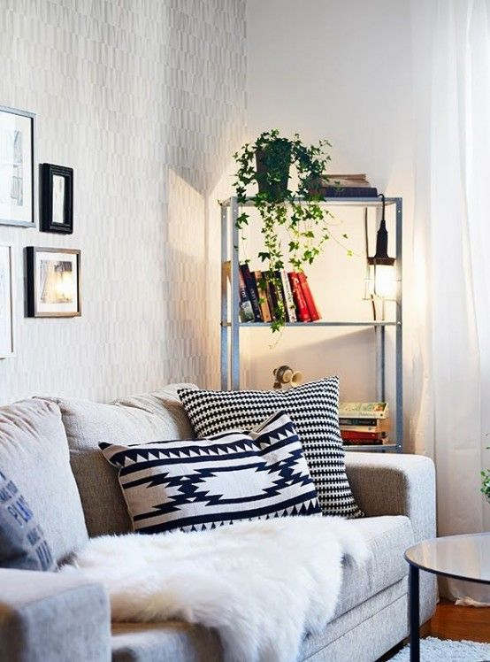 an IKEA Hyllis shelving unit with books, greenery and hanging .