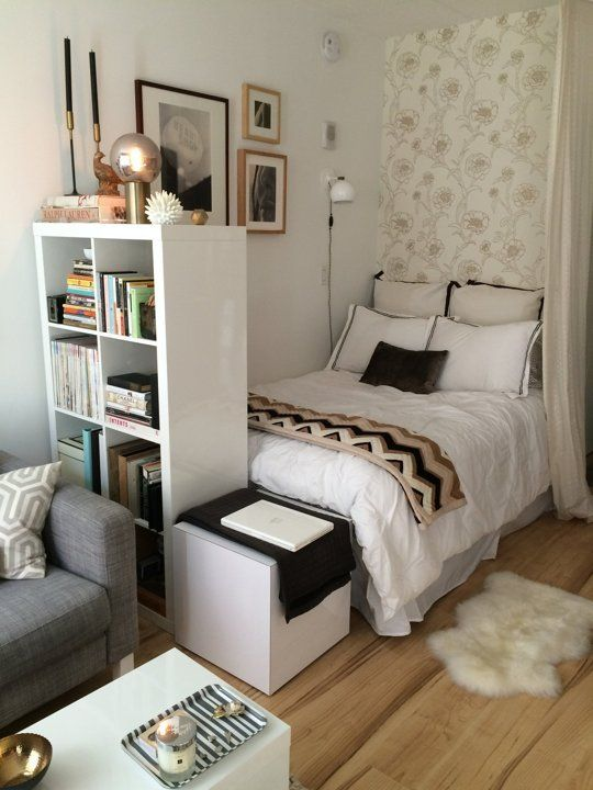 I love the combination of neutral colors in this snug studio .