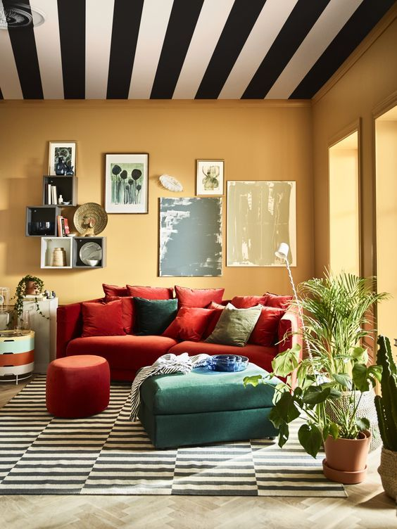 a colorful space with an orange Stockholm sofa and a green ottoman .