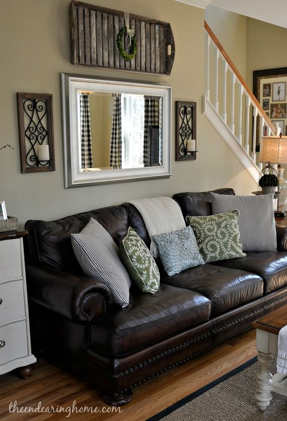 Adding a mirror above the sofa is a great way to create the sense .