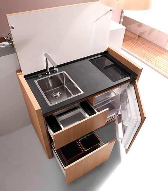 These Compact Kitchens from French company Kitchoo, look like a .