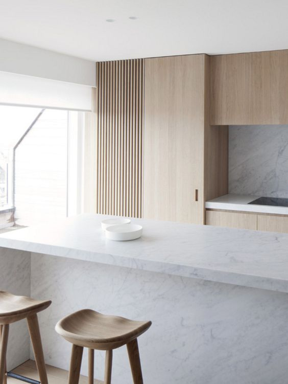 A Kitchen With Marble Kitchen Island And Some Wooden Stools How to .