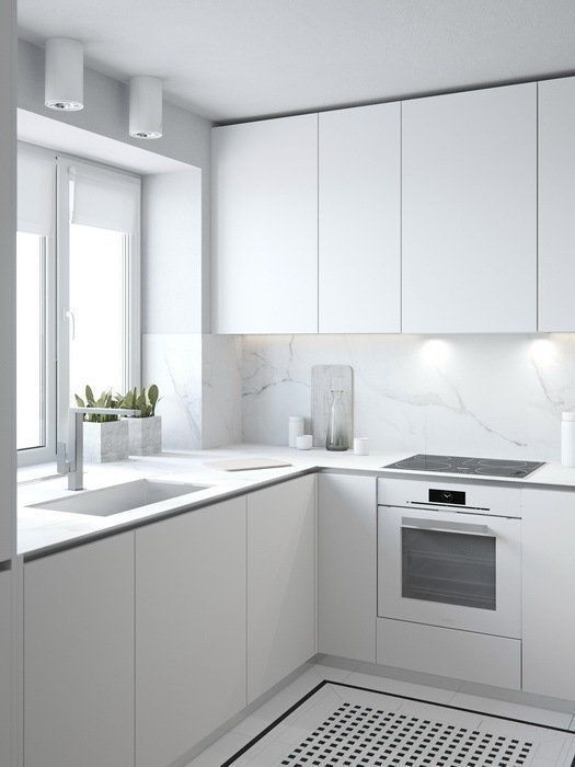 a pure white minimalist kitchen is made more catchy with marble .
