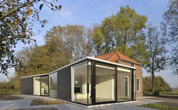Interesting Architecture Duo: Modern Extension to Small Farmhouse .