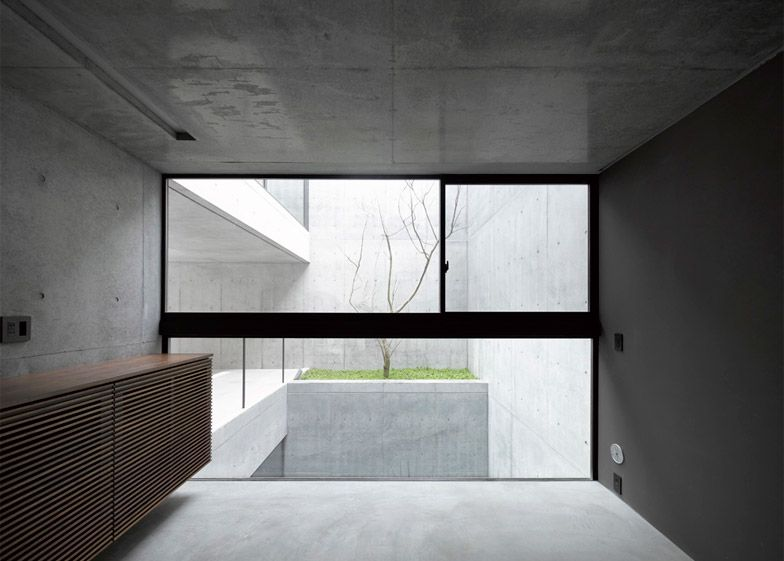 This raw concrete house in Tokyo was designed by Japanese firm .