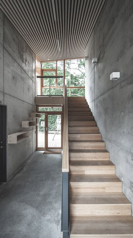 Inside, raw concrete walls and floors are paired with pine plywood .
