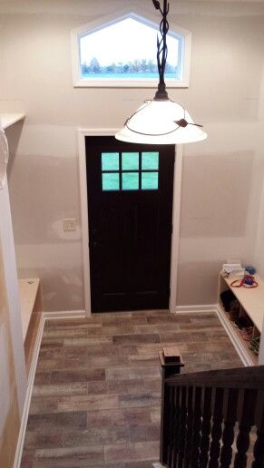 Raised ranch remodel interior entryway bump out extension | Raised .