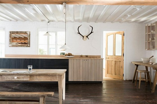 Rustic Kitchen With An Extensive Use Of Rough Wood - DigsDi