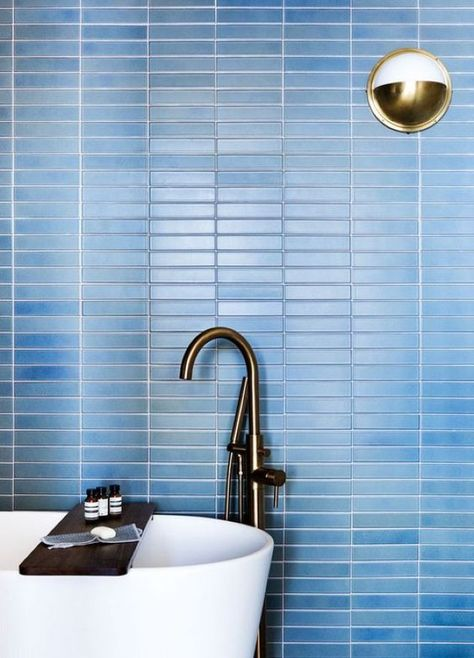 Contemporary Bathroom With Laconic Blue Skinny Tiles On The Wall .