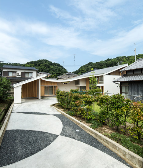 Shawl House By Y+M Design Office Has A Roof That Slopes Down To .