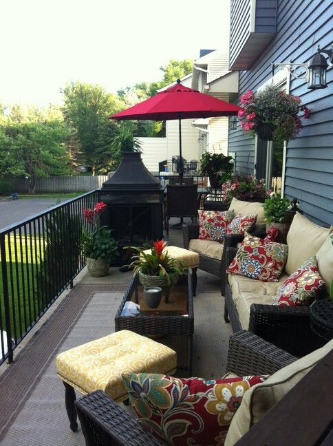 Created 2 areas on a long skinny deck Seating area and dining area .