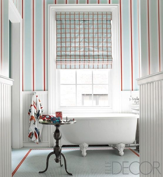 A traditional footed tub is offset by custom painted walls that .