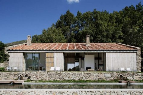 Spanish stable turned contemporary stone home | Vacation homes for .