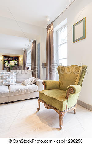 Stylish armchair in a cosy interior. Stylish plush armchair in a .