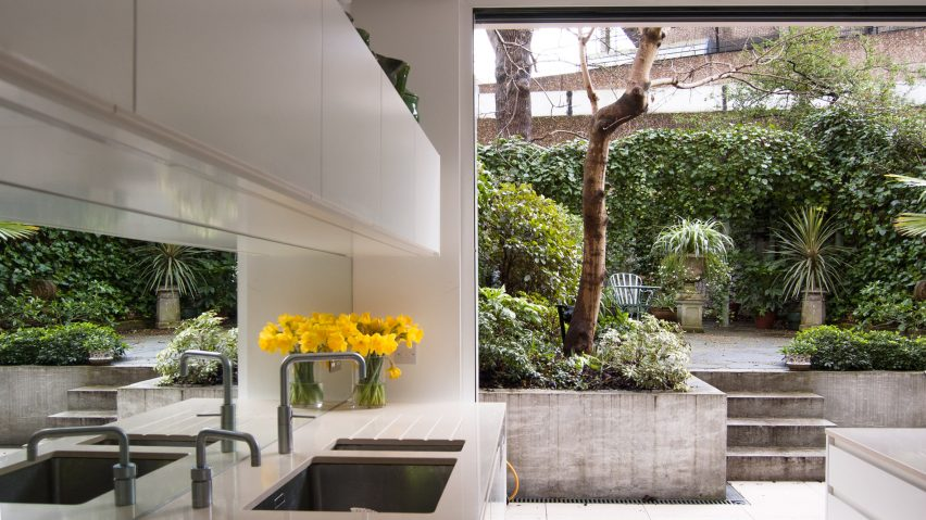 House revamped by William Tozer Associates to match brutalist .