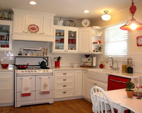 red and white vintage inspired kitchen   Cottage kitchen cabinets .